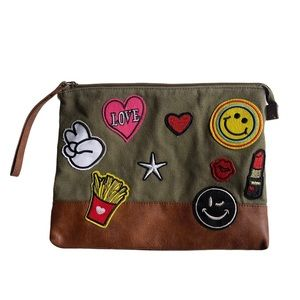 American Eagle green wristlet with patches